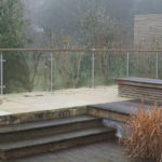 natural stone covered in lichen and rotten ipe decking